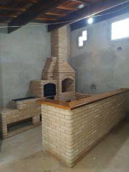 Churrasqueira 0,95 x 0,70 com forno e fogão a lenha, balcão em L com prancha rustica